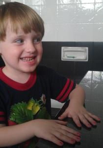 My eldest son wearing nail polish