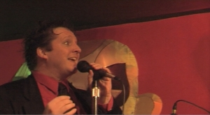 R Kevin Garcia Doyle in screen shot from He Makes You Laugh music video