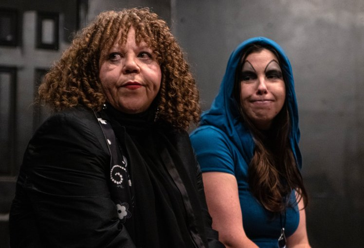 Diana Brown and Dominica May as Villains looking off stage